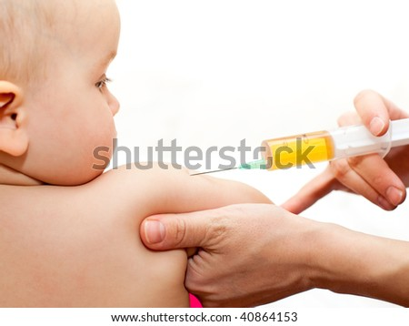 Doctor giving a child a huge injection in arm, shallow DOF - stock photo