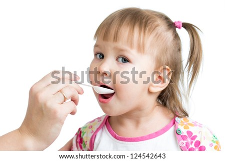 doctor giving drug to child girl isolated on white