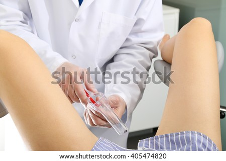 Doctor gynecologist performing an examination  - stock photo