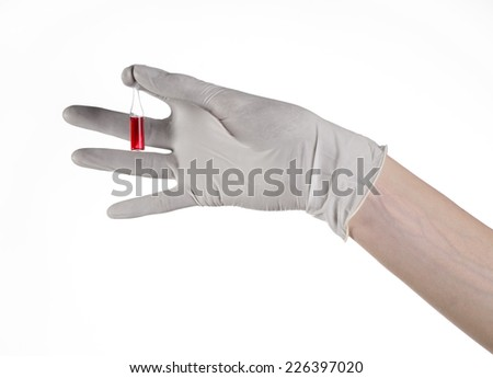 Doctor hand holding a vial, ampule red, vaccine ampule, Ebola vaccine, flu treatment, white background, isolated, gloved hand holding a vial, cancer vaccine, a vaccine against Ebola - stock photo
