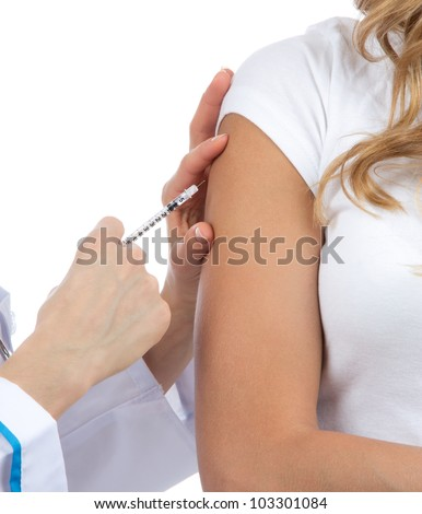 Doctor hand make  patient insulin flu shot by syringe subcutaneous arm injection vaccination isolated on a white background - stock photo