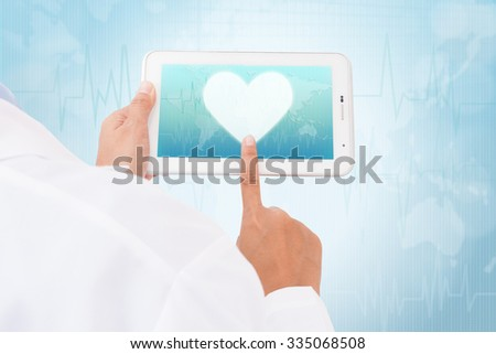 Doctor hand touch screen heart symbol on a tablet. medical icon - stock photo