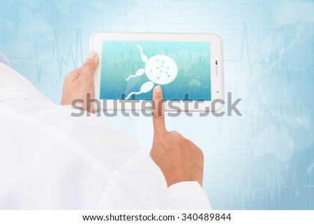Doctor hand touch screen Spermatozoon symbol on a tablet. medical icon - stock photo