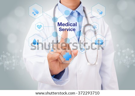 Doctor hand touching medical service sign on virtual screen. medical concept - stock photo