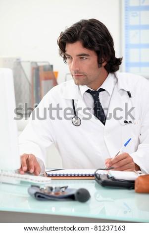 Doctor handing a prescription - stock photo