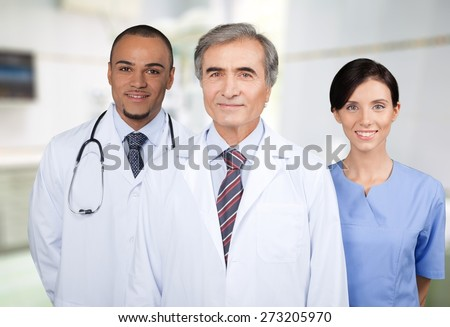 Doctor. Happy doctors standing together - stock photo