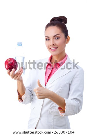 Doctor happy smiling holding apple and water bottle. Healthy lifestyle photo of Caucasian doctor isolated on white background. - stock photo