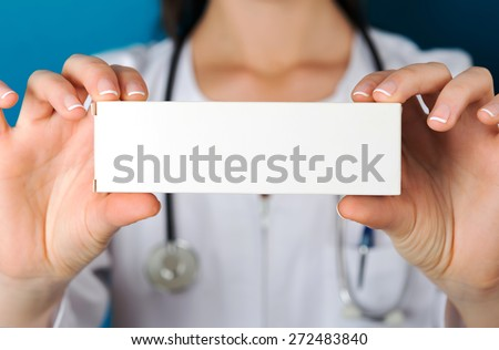 Doctor holding a medicine packet - stock photo