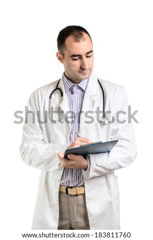 Doctor holding a pen and checking reports.