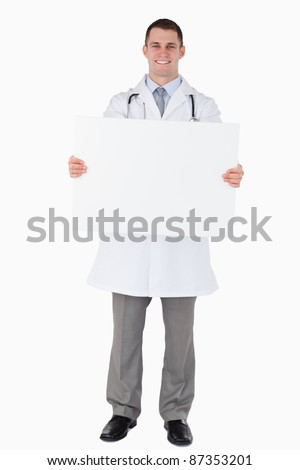 Doctor holding a sign on white background - stock photo