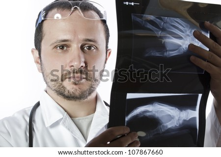 Doctor holding an x-ray appeal of a hand - stock photo
