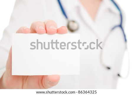 Doctor holding blank card on white background.