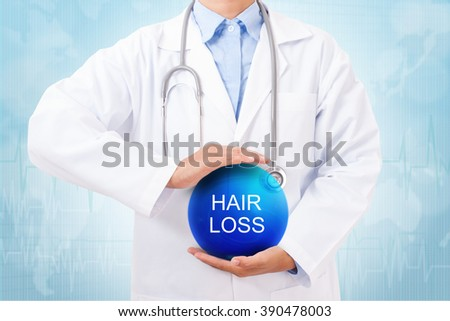Doctor holding blue crystal ball with hair loss sign on medical background.