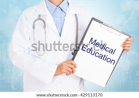 Doctor holding clipboard with medical education text on a sheet of paper on white background