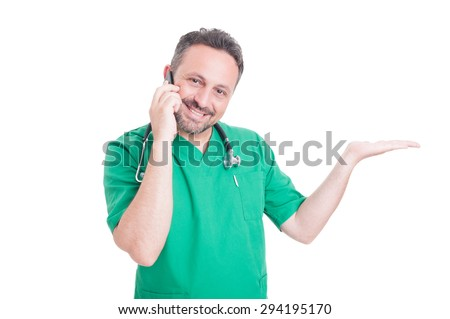 Doctor holding copyspace or text space while talking on the phone isolated on white background - stock photo