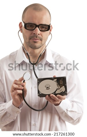 Doctor holding hard disk and stethoscope over white background - stock photo