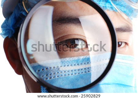 doctor holding magnifier on an isolated white background - stock photo