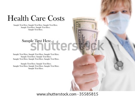 Doctor Holding Money with Focus on Money - stock photo