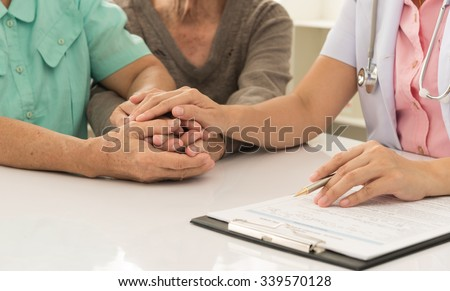 Doctor holding patients's hand for encouraging and comforting. - stock photo