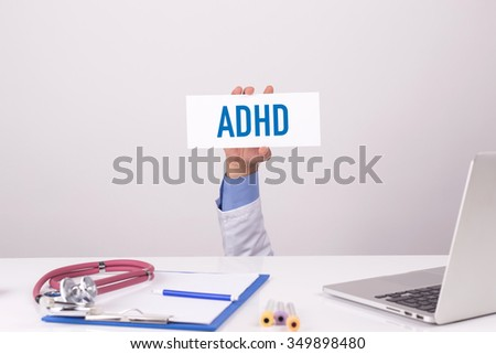 Doctor Holding Placard written ADHD