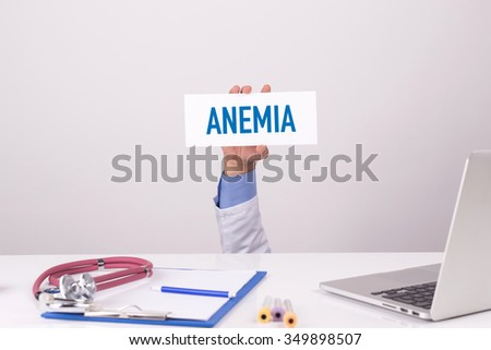 Doctor Holding Placard written ANEMIA
