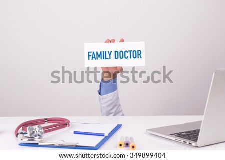 Doctor Holding Placard written FAMILY DOCTOR