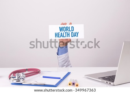 Doctor Holding Placard written WORLD HEALTH DAY