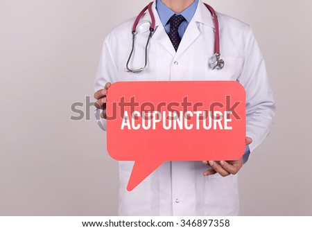 Doctor holding speech bubble with ACUPUNCTURE message - stock photo