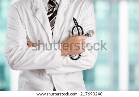 Doctor holding stethoscope. - stock photo