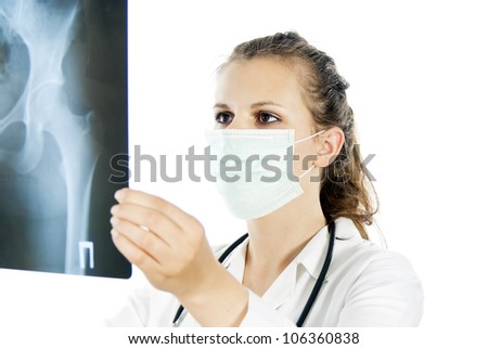 doctor in a mask with an X-ray photograph
