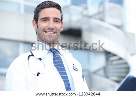 doctor in front of stairs - stock photo