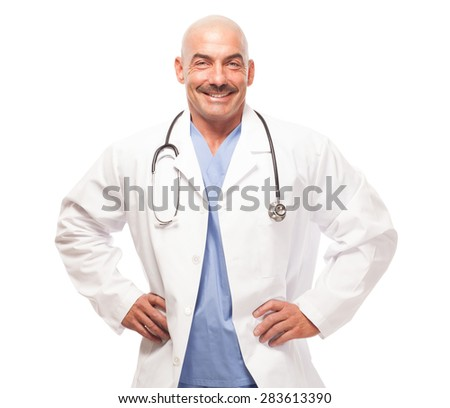 Doctor in scrubs and lab coat on white background with hands on hips. - stock photo
