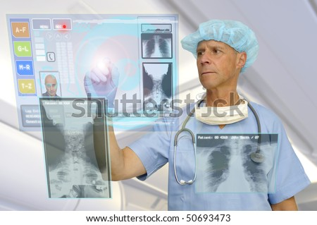 Doctor in uniform with high-tech screen in the hospital - stock photo