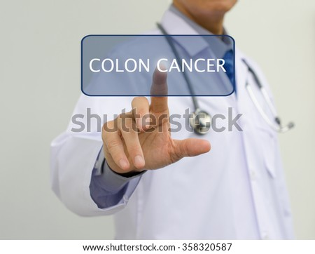 Doctor in white gown touching colon cancer button on virtual screen, health care and medical concept.