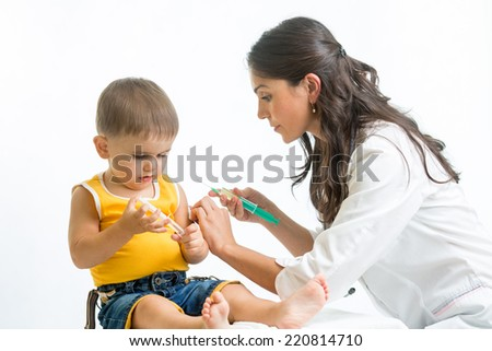doctor injecting baby - stock photo
