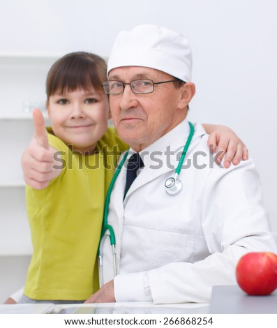 Doctor is examining a cute girl - stock photo