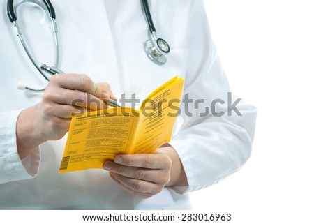 Doctor is filling out an international certificate of the vaccination