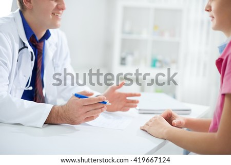 Doctor is happy and he discuss about patient results with nurse - stock photo