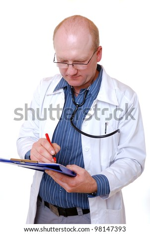 doctor is making notes on his clip board