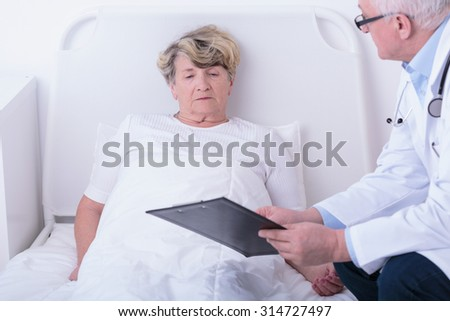 Doctor is showing the test results to his patient