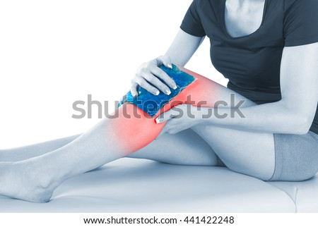 Doctor is stretching woman leg on physiotherapy session. - stock photo