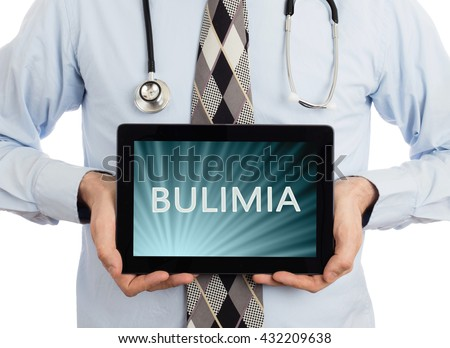 Doctor, isolated on white background,  holding digital tablet - Bulimia - stock photo