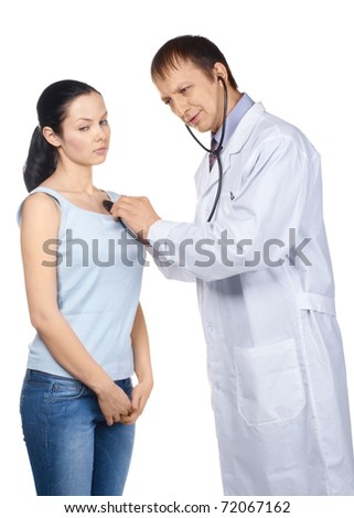 Doctor listening the heartbeat of his patient with a stethoscope, over white background