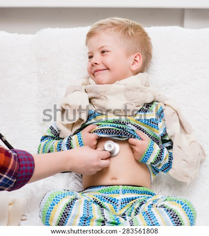 Doctor listening to heartbeat with stethoscope - stock photo
