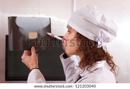 Doctor  looking an x-ray image in clinic - stock photo