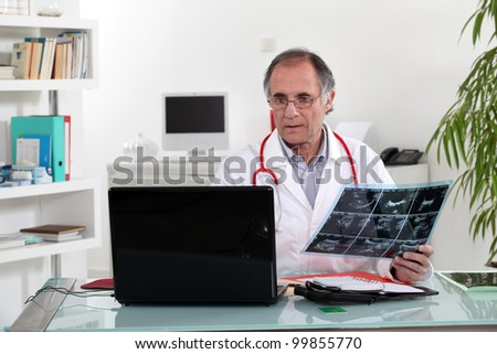Doctor looking at an xray - stock photo