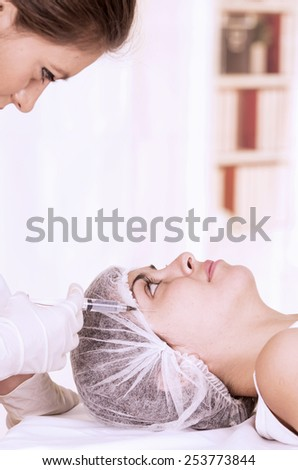 doctor looking at patient ready for surgery in the or isolated on white - stock photo