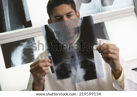 Doctor looking at x-rays - stock photo