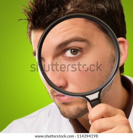 Doctor Looking Through Magnifying Glass On Green Background - stock photo