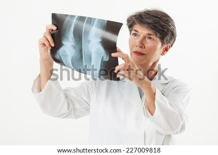 Doctor looking x-ray image.